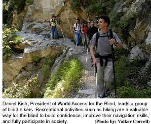 Picture 1: Daniel Kish, President of World Access for the Blind, leads a group of blind hikers. Recreational activities such as hiking are a valuable way for the blind to build confidence, improve their navigation skills, and fully participate in society. (Photo by: Volker Correll)